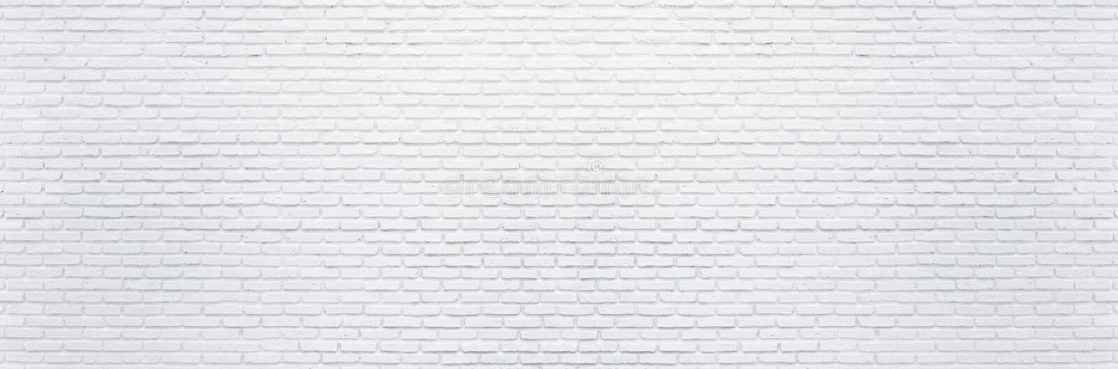 Abstract white brick wall texture background. Horizontal panoramic view of masonry brick wall. For interior design stock photo