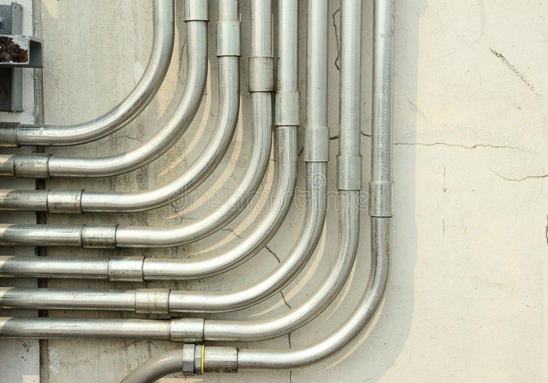 Aluminum tubing for wire protection lined royalty free stock photos