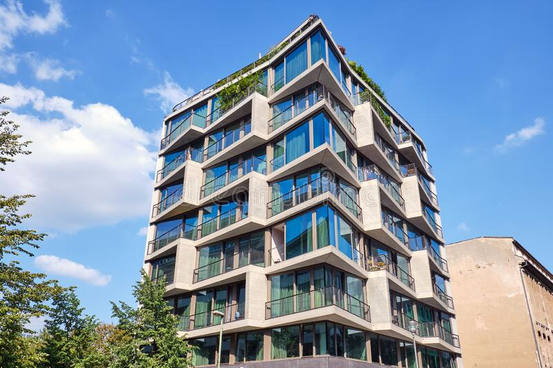 Apartment building with floor-to-ceiling windows. Seen in Berlin, Germany stock photos