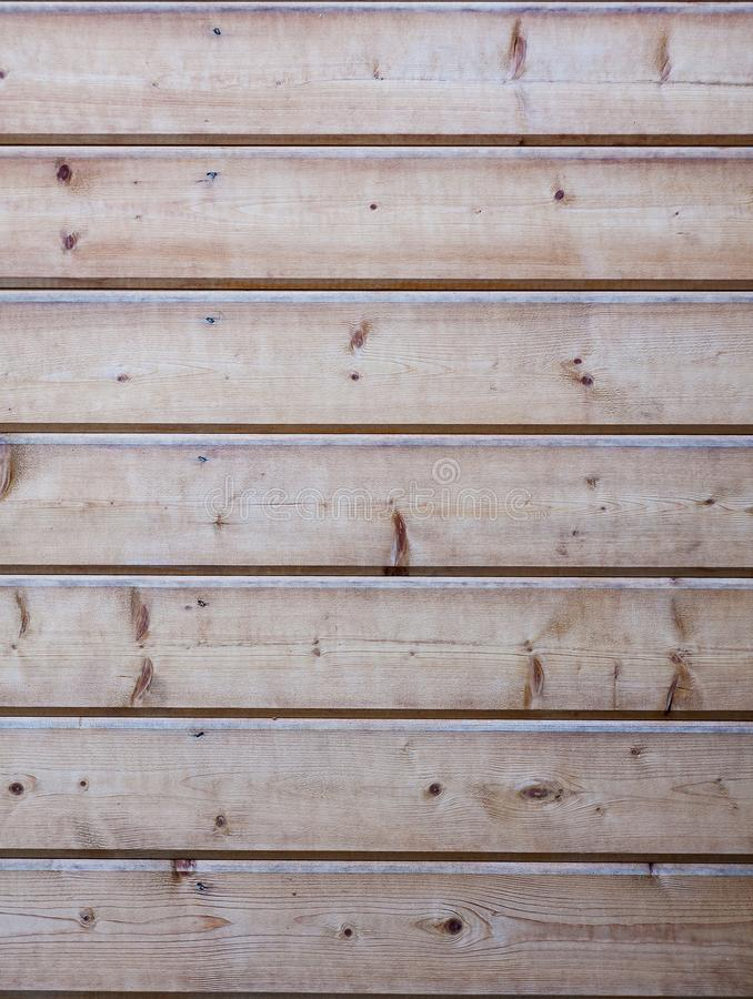 Background. Wall, sheathed with clapboard. Horizontal tree. Texture. The wall is sheathed with wood horizontally.Clapboard. The texture of the wood stock image