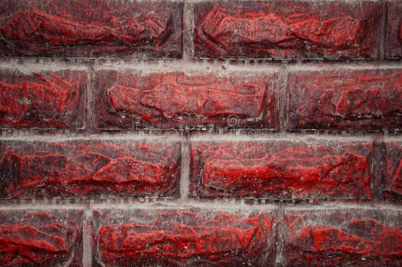 Background wall and stone texture, for exterior. Finishing stone, design. Red, dirty, with dust and drips from the rain. Background wall and stone textures, for royalty free stock photos