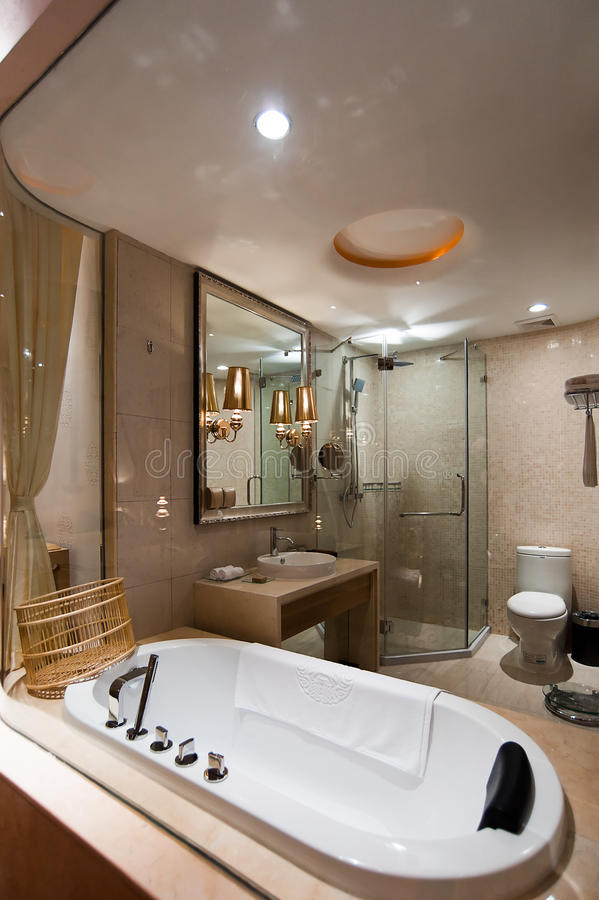 Bathroom. Simple modern bathroom,including separate shower in glass wall, bathtub, toilet, wash basin and Mirror stock image