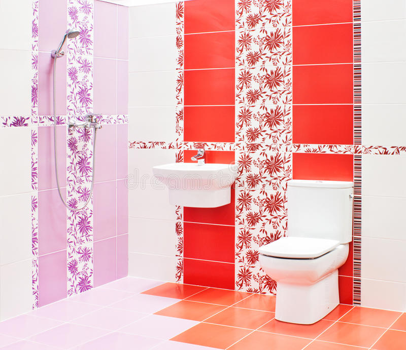 Bathroom with toilet and sink. Modern red and pink bathroom with toilet and sink royalty free stock photography