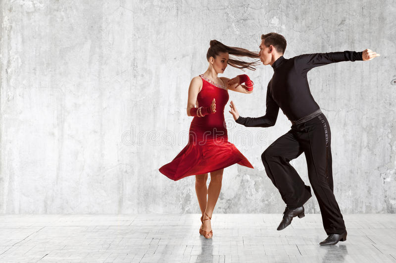 Beautiful couple in the active ballroom dance on wall royalty free stock photos