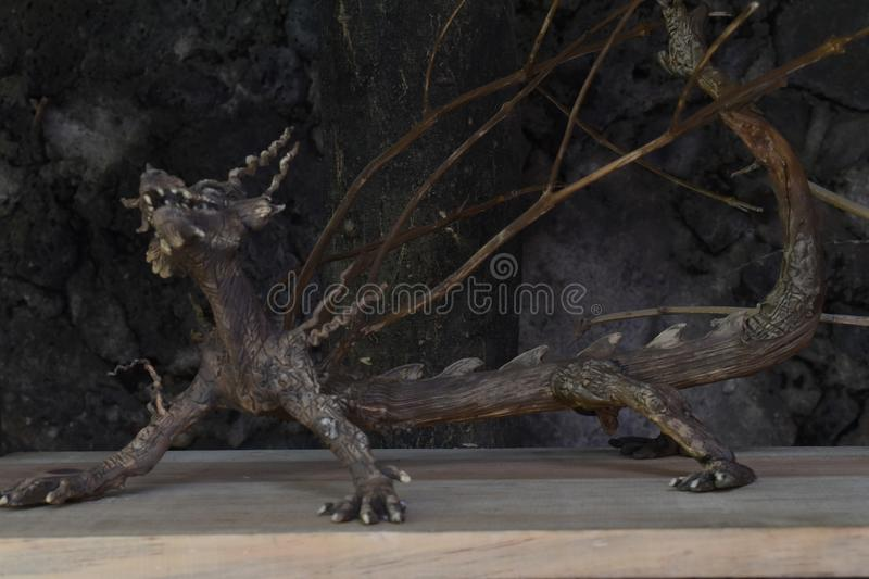 A beautiful mythological decoration of a tree bark dragon. A  wonderful decoration of a fantastic animal made by tree bark royalty free stock photos