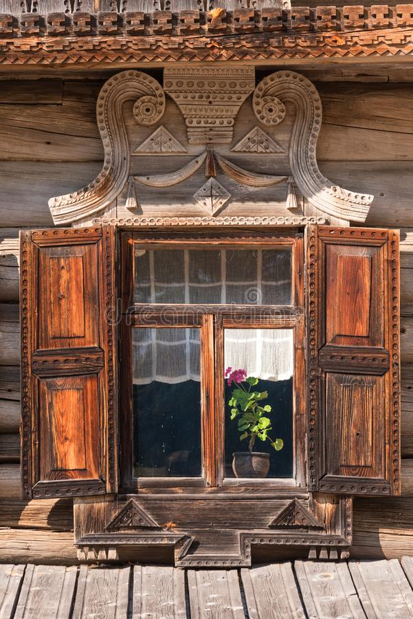 Beautiful old window with carved frame in the Russian village stock photo