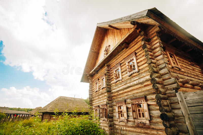 Beautiful Russian log hut with two floors. View of the two-storey timbered log hut Russian royalty free stock photos