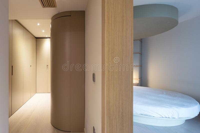 Bedroom with a round bed and an adjoining dressing room stock image