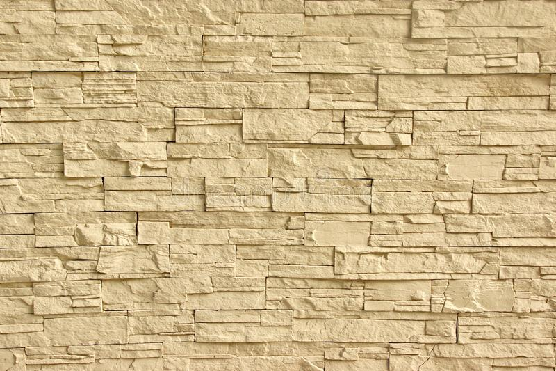 Beige Artificial Stone Wall royalty free stock photography