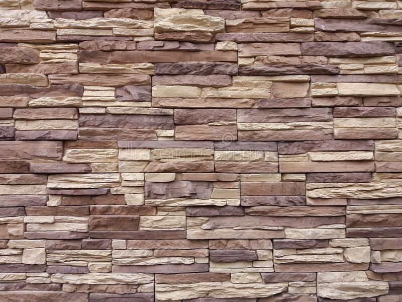 Beige brown artificial stone wall texture stock image