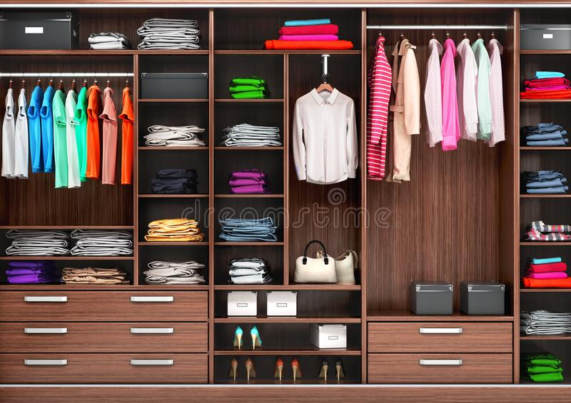 Big wardrobe with different clothes for dressing room. royalty free stock photo
