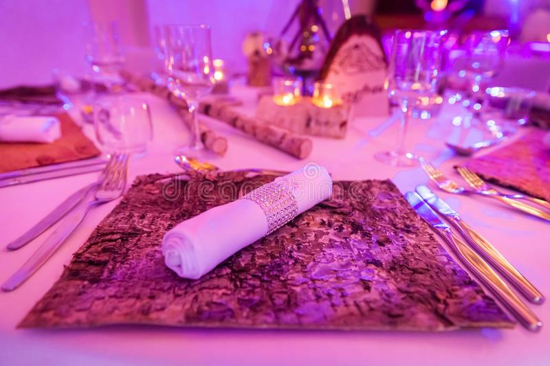 Birch Wedding Table Decoration and Napkin on Wood Bark Mat. Birch Wedding Table Decoration with White Napkin on Wood Bark Mat royalty free stock photo