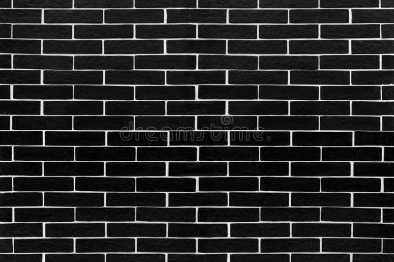 Black brick tiles with white contrasting grouting. Background stock photos