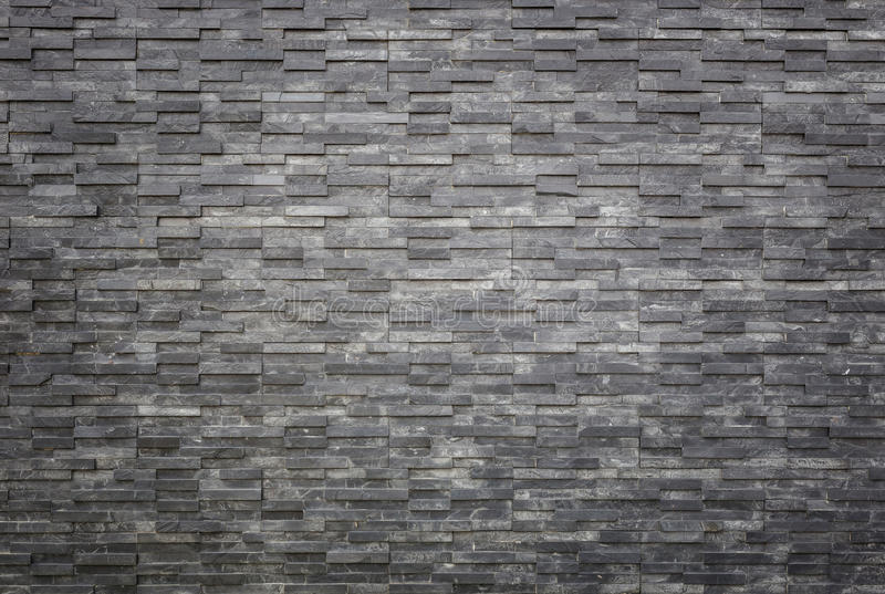 Black slate wall texture and background. Interior or exterior de. Pattern of black slate wall texture and background. Interior or exterior decoration stock photography