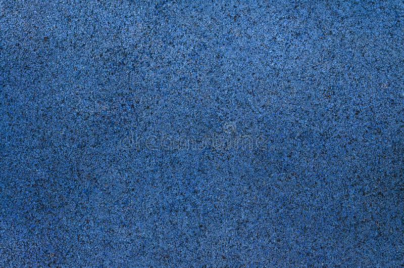 Blue background texture from marble chips. Plaster texture. Speckled colorful natural background stock images