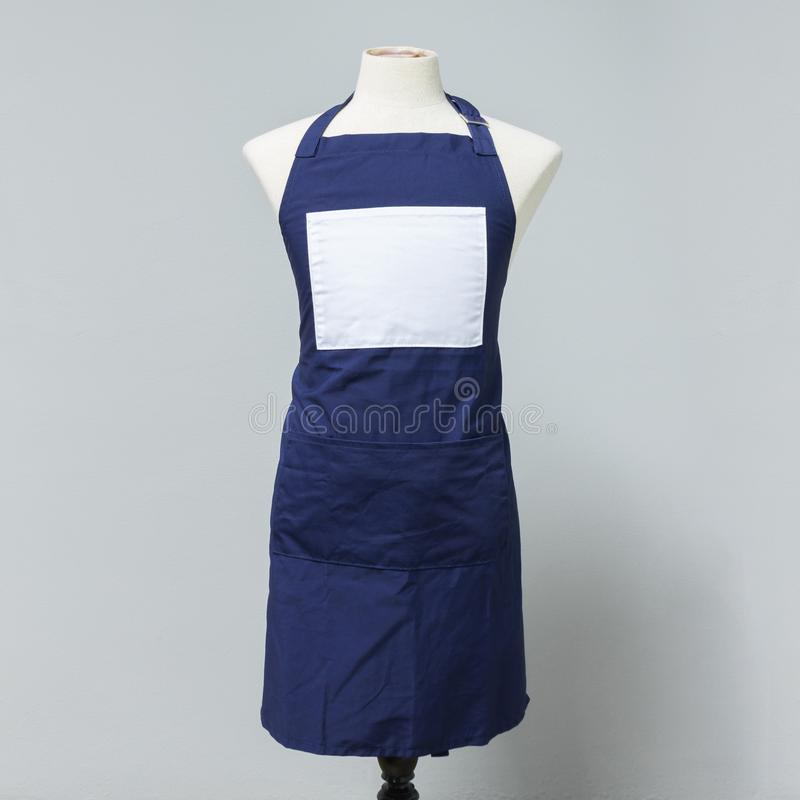 Blue canvas apron uniform on mannequin for designer. Housewife costume for cooking or cleaner stock photos