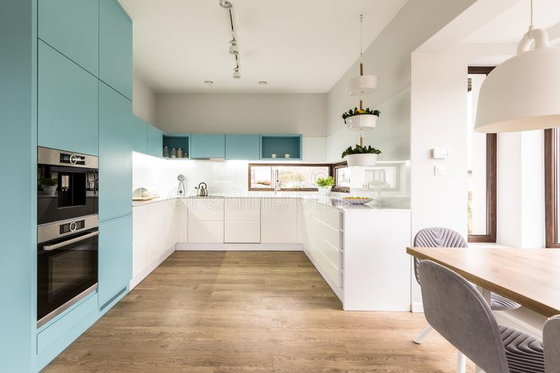 Blue and white kitchen interior royalty free stock photography