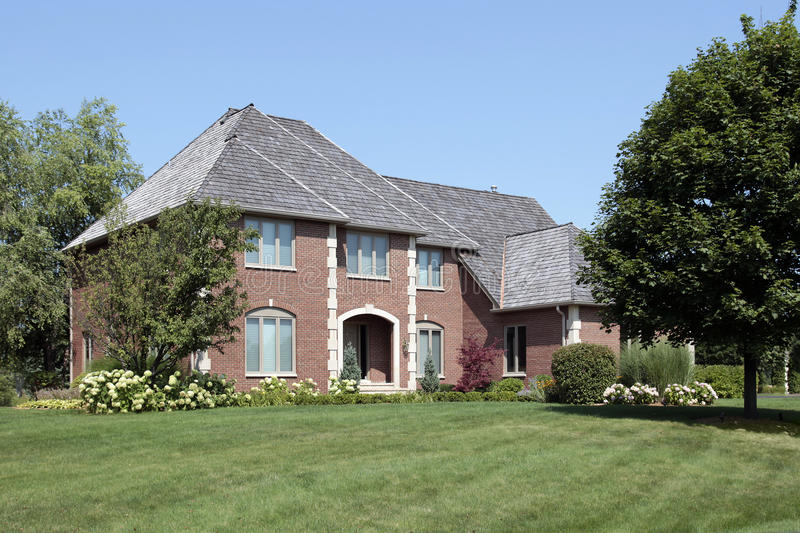 Brick home with arched entry stock photo
