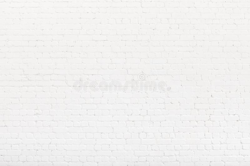 Brick wall painted with white paint. White Loft background, texture. Copy space stock image