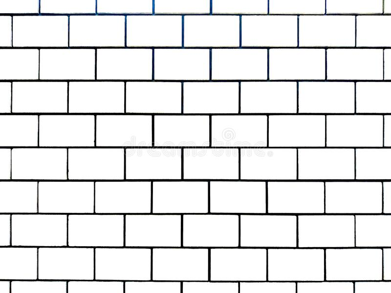 Brick wall of white large bricks. With dark ceilings for the background royalty free stock image