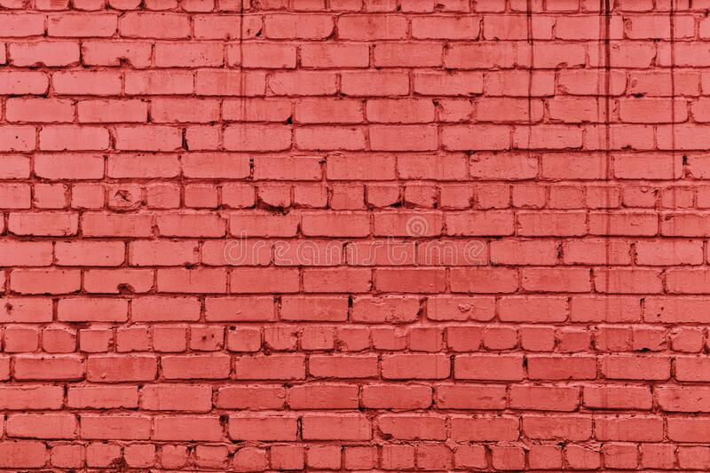 Bright coral color painted old brick wall texture. Red rough brickwork. Abstract masonry grunge industrial background royalty free stock photo