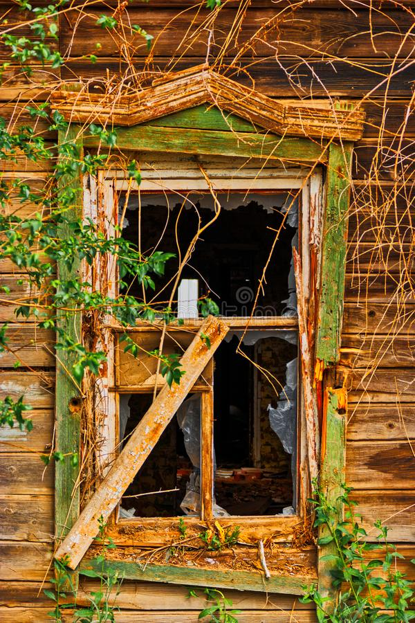 Broken window of old wooden house in folk russian style. Without glasses royalty free stock photos