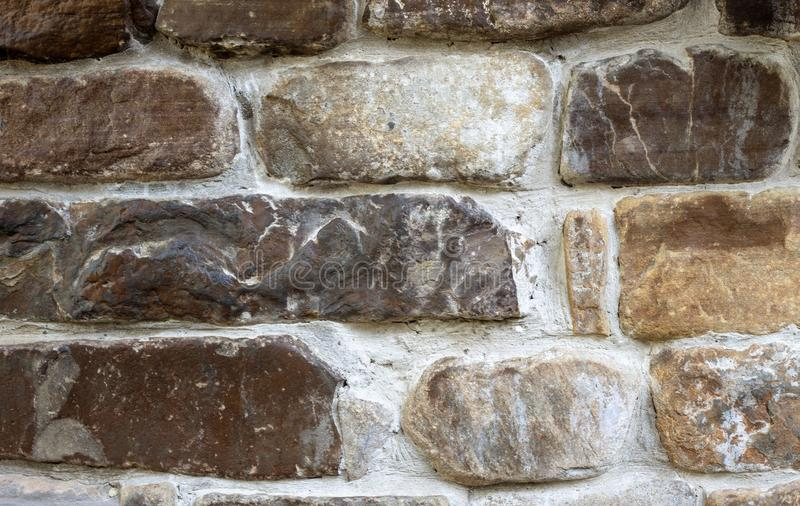 Brown old stone bricks wall decorative finishing. For the castle royalty free stock photos