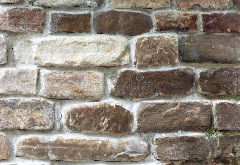 Brown old stone bricks wall decorative finishing. For castle stock photography