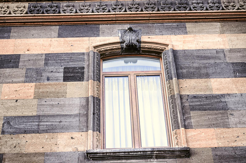 Carved stone pattern on the cornice and arched window frame royalty free stock images