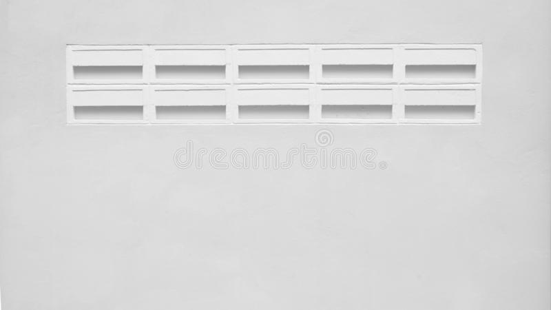 Cement brick for air ventilation at the wall. Background stock photos