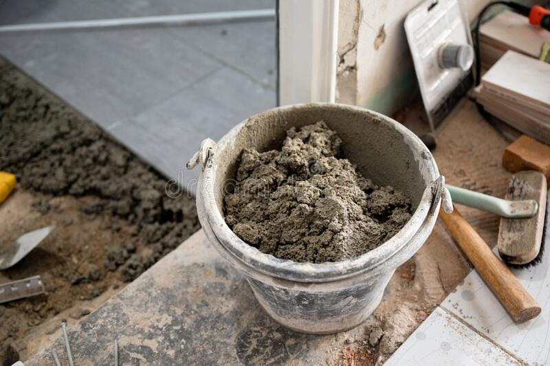 Cement in can with tools preparation install tile. Cement in can with tools preparation for install tile stock image