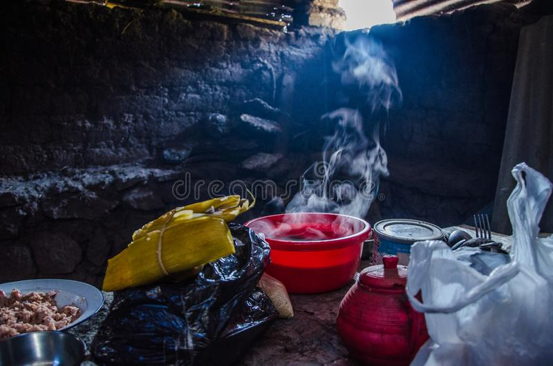 Cheap clay and wooden dish on the table in a village house stock photography