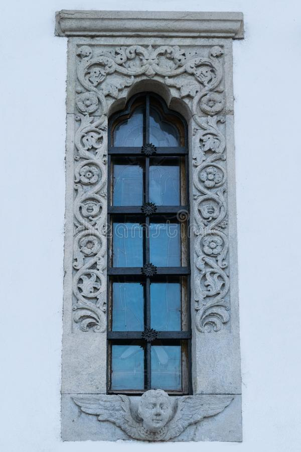 Church window with beautiful elaborate stone carved frame royalty free stock photos