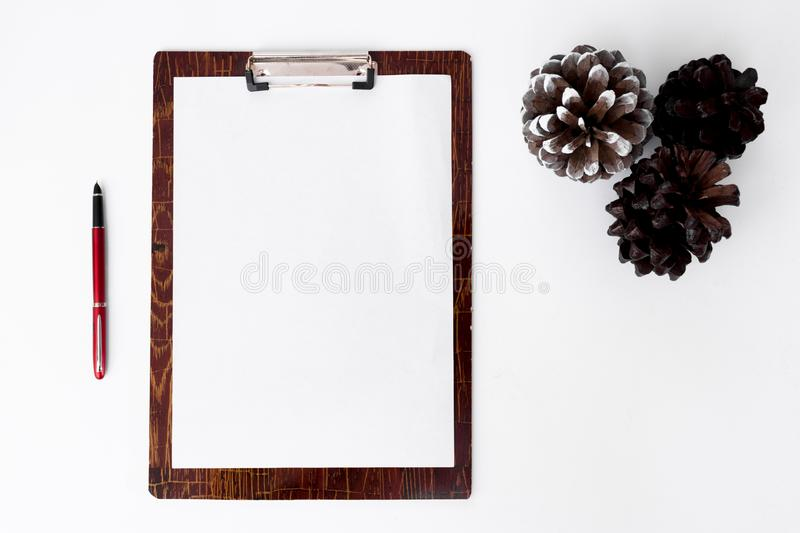 Clipboard christmas composition for christmas time. stylish cones arrangement on white background. royalty free stock image