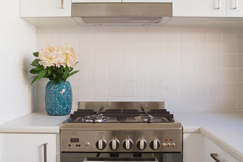 Close up of kitchen oven and tiled splashback. In contempory apartment royalty free stock image