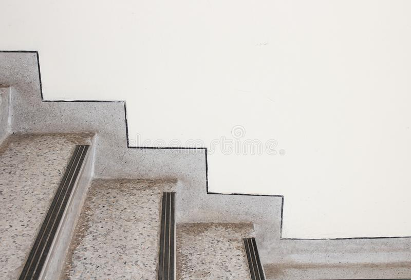 Close up Stairs terrazzo,marble floor in sideways of a wall.  royalty free stock photos