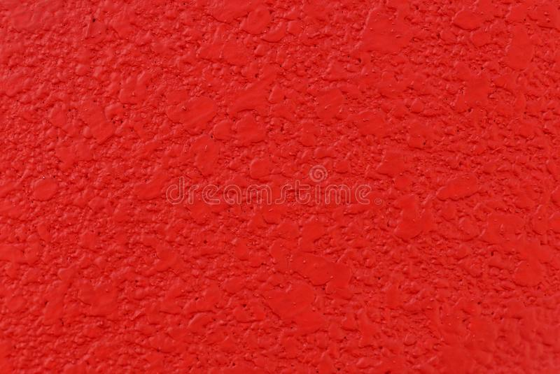 Close up view of red wall texture for background stock image