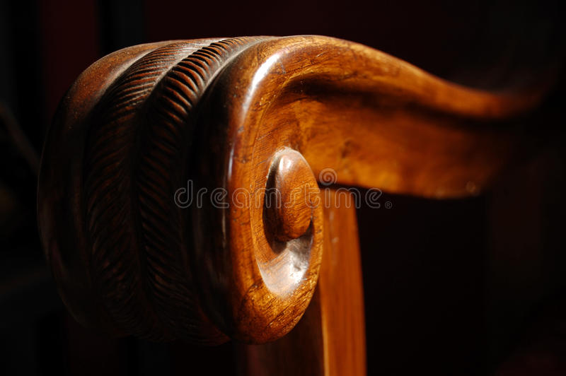 Close up of wooden sofa handle in morning light.  royalty free stock photo
