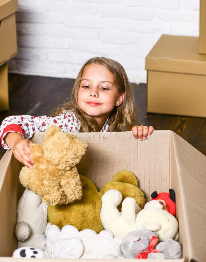 Come home with confidence. purchase of new habitation. Cardboard boxes - moving to new house. repair of room. new. Apartment. happy little girl with toy. happy stock photos