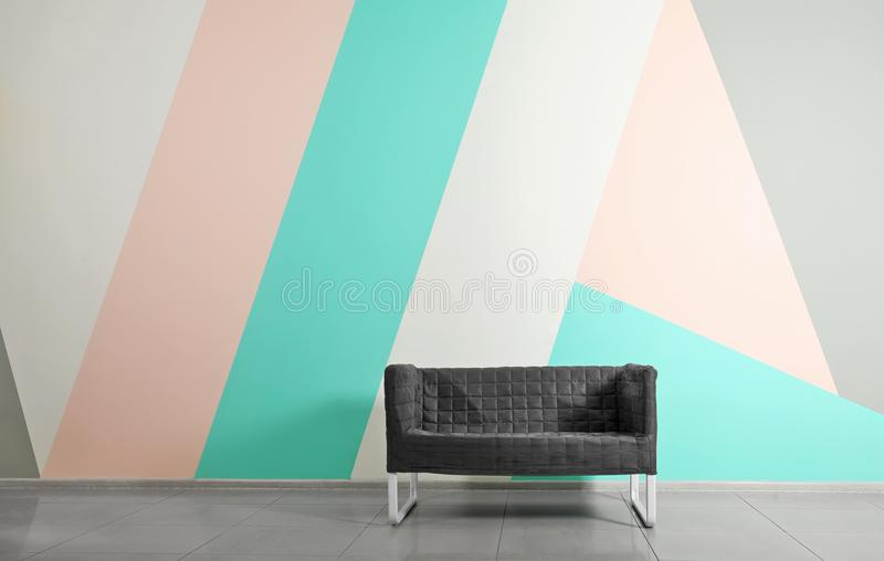 Comfortable dark sofa in room stock photography