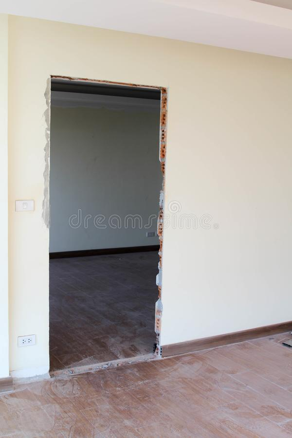 Punctured wall for door installation. Concrete wall is punctured for door installation stock photos