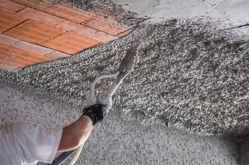 Construction worker applying cement plaster stock photos