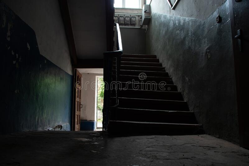 Dark staircase inside with a staircase to the second floor in an old house in Ukraine in the cities of Dnieper stock images
