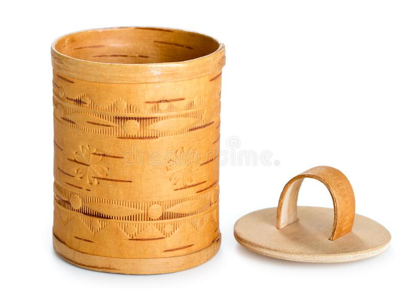 Decorative handmade barrel with embossing made of birch bark. Decoration for house, box for small things isolated on white. Background stock photos