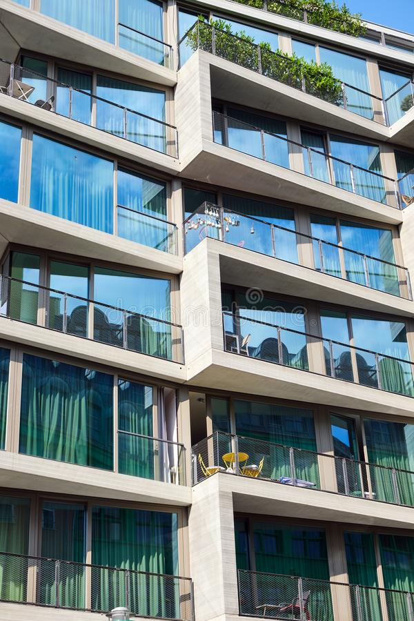 Detail of an apartment building with floor-to-ceiling windows. Seen in Berlin, Germany royalty free stock image
