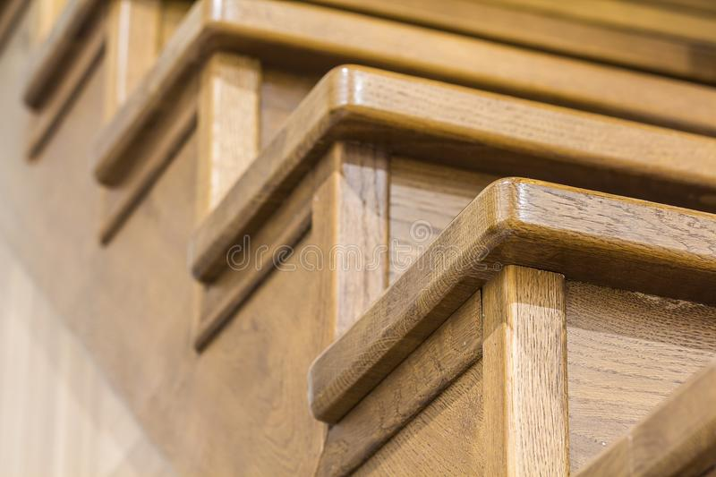 Detail close-up image of wooden oak stairs in house interior royalty free stock images