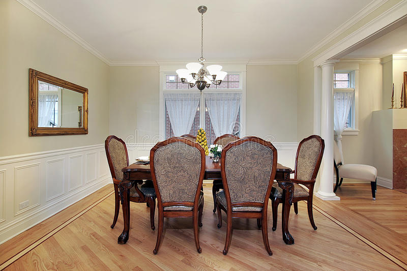 Dining room in luxury home stock photography