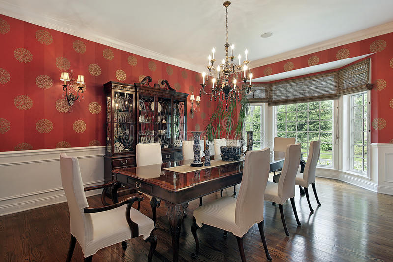 Dining room with red walls royalty free stock photography