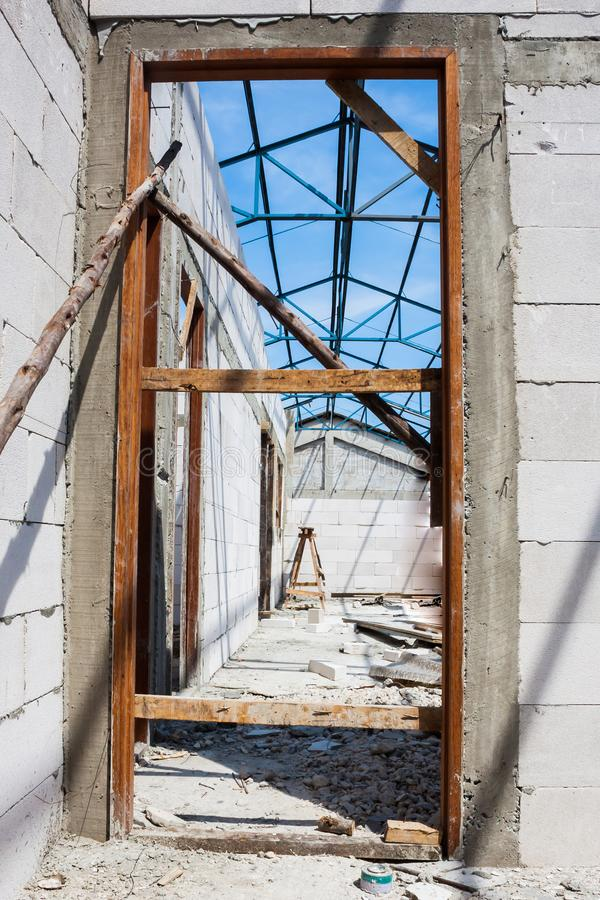 Door jamb installation in concrete wall. Construction site work royalty free stock images