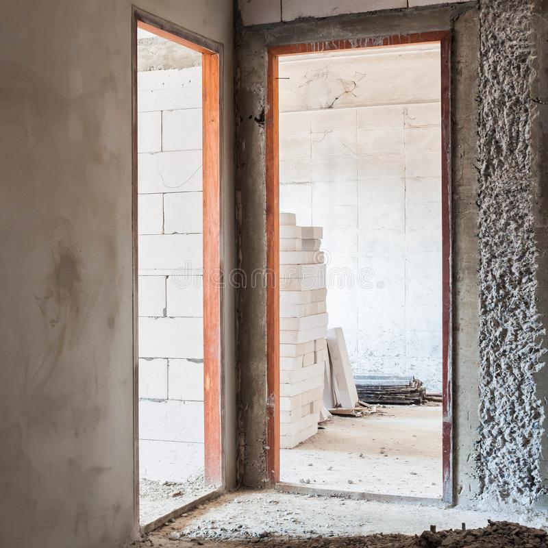 Door jamb installation in concrete wall. Modern design house stock images